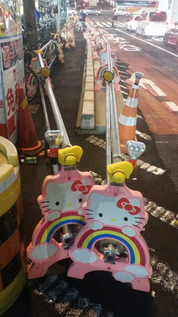 Kawaii Hello Kitty road safety barriers block off a construction zone outside Shinjuku station in Tokyo