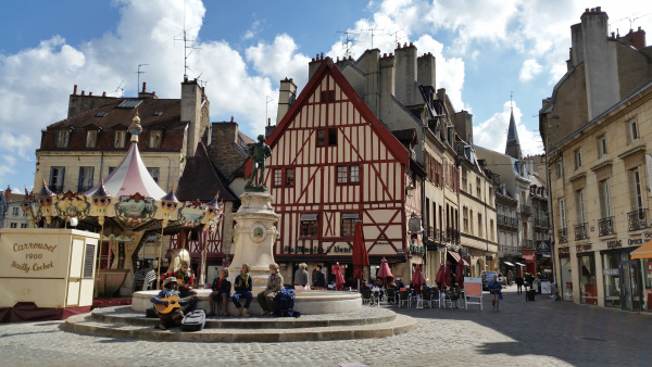 square in dijon with traditional wooden buildings in france