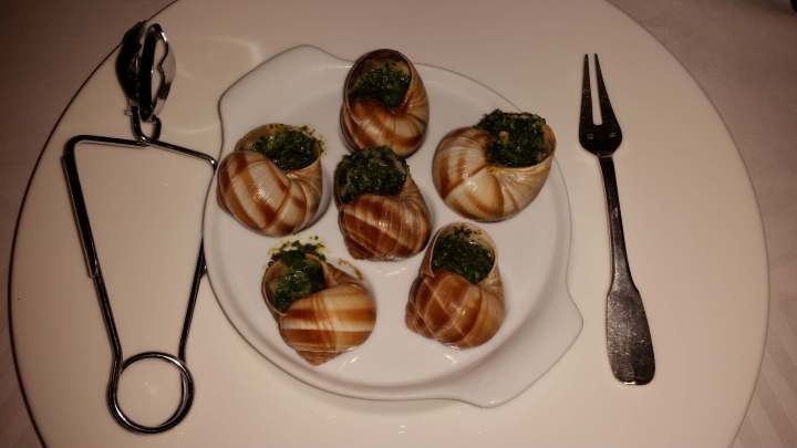 plate of escargot in france