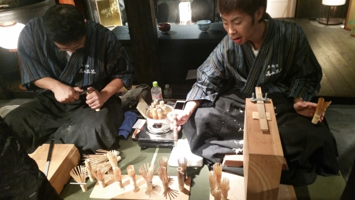 Japanese craftsmen hand making bamboo matcha whisks