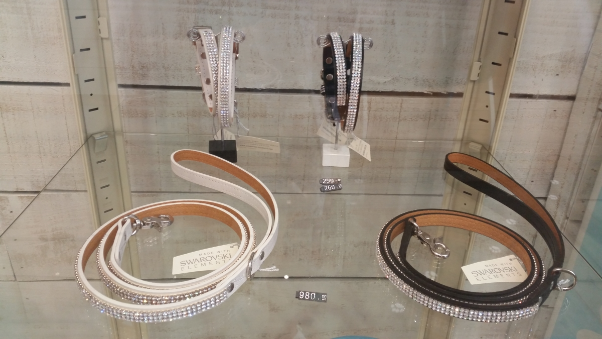 Swarovski crystal dog collars and leads in glass display from Hachi dog boutique South Yarra Melbourne Australia