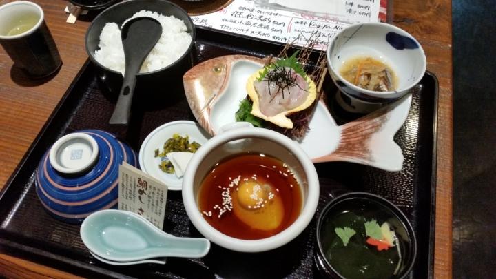 Local Uwajima food tai-meshi is raw sea bream dipped in egg and soy sauce broth from Kadoya restaurant